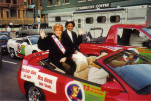 Joan, as Ms.Illinois Senior, rides alongside Ms. Illinois in the Annual Christmas Parade in Downtown Chicago